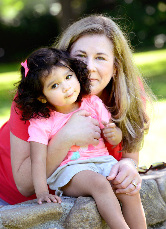 """. Suzy Campeau, 51, of South Pasadena, poses with 2-year-old Bella, who she adopted with her husband Greg last December, poses in her neighborhood park Saturday, May 11, 2013. This will be Suzy\'s first \""""official\"""" Mother\'s Day.  (SGVN/Staff Photo by Sarah Reingewirtz)"""