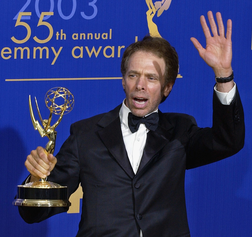 """. Executive producer Jerrry Bruckheimer displays the Emmy for outstanding reality/competition program won by \""""Amaqzing Race\"""" at the 55th annual Primetime Emmy Awards Sunday, Sept. 21, 2003, in Los Angeles. (AP Photos/Mark J. Terrill)"""