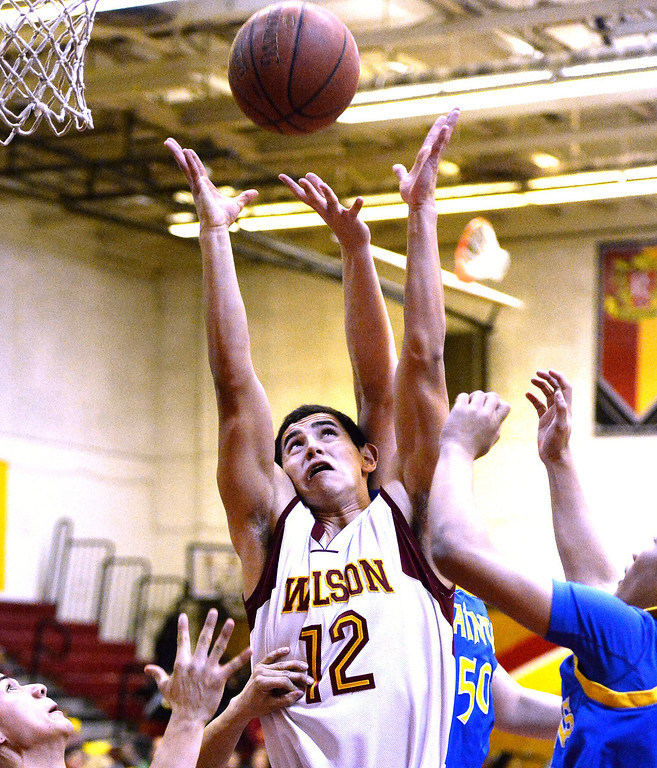 . Wilson\'s Anthony De Leon (12) rebounds against San Dimas in the first half of a prep basketball game at Wilson High School in Hacienda Heights, Calif., on Friday, Jan. 31, 2014. (Keith Birmingham Pasadena Star-News)