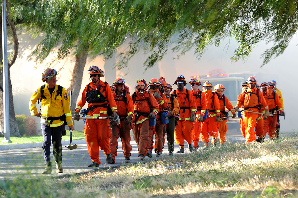 . (John Valenzuela/Staff Photographer)  Cal Fire battles a brush  fire that ignited about 12:38 p.m. today and has since grown to 1,700 acres, according to Cal Fire officials.