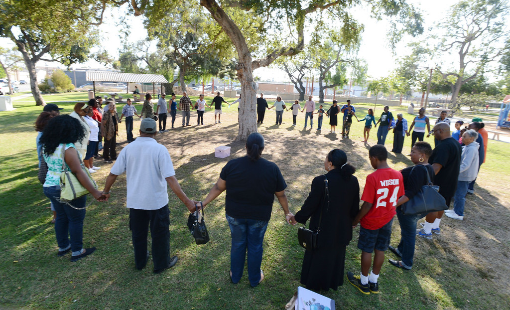 . Long Beach, Calif., -- 10-12-13- Friends and family gather near the scene where teacher Kellye Taylor,53, was fatally  stabbed in front of her students, at Orizaba Park  Friday October 11th 2013, in Long Beach Calif.    Stephen Carr/  Daily Breeze