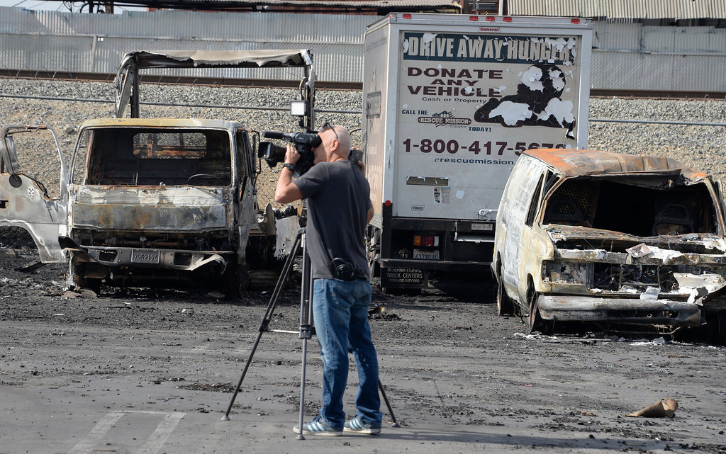. The charred remains of the San Fernando Valley Rescue Mission\'s vehicle fleet on May 8, 2014 after a fire destroyed the mission\'s North Hollywood emergency shelter, vehicle fleet, clothing warehouse and food pantry. (Photo by Gene Blevins/Los Angeles Daily News)