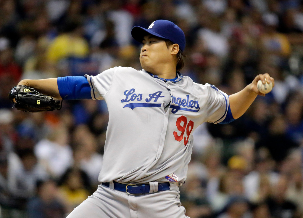 . Los Angeles Dodgers starting pitcher Hyun-Jin Ryu throws during the first inning of a baseball game against the Milwaukee Brewers Wednesday, May 22, 2013, in Milwaukee. (AP Photo/Morry Gash)