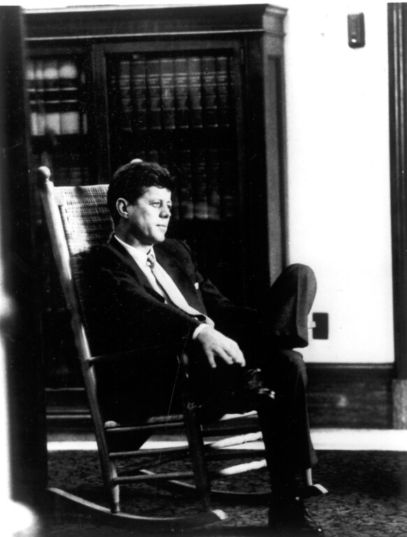 . President Kennedy relaxes in his rocker in the White House Oval Office. (1962)   Los Angeles Daily News file photo