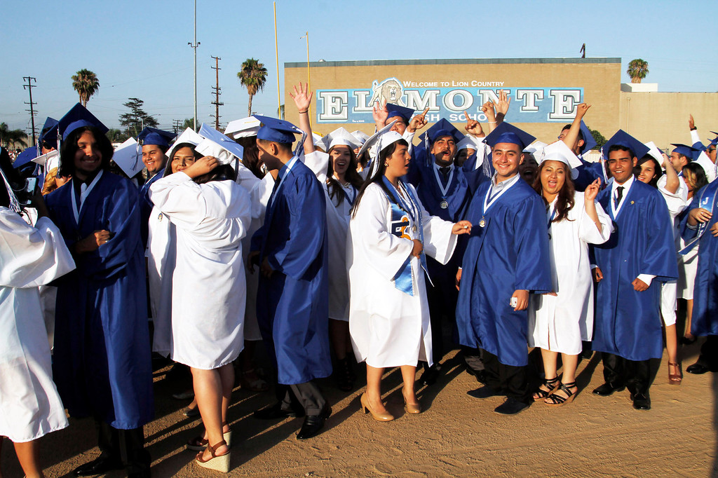 . Jubilant graduates during the El Monte High School Class of 2014 Commencement Ceremony, at El Monte High School\'s Football Stadium in El Monte, CA., Wednesday, June 11, 2014.  (Photo by James Carbone for the San Gabriel Valley Tribune)