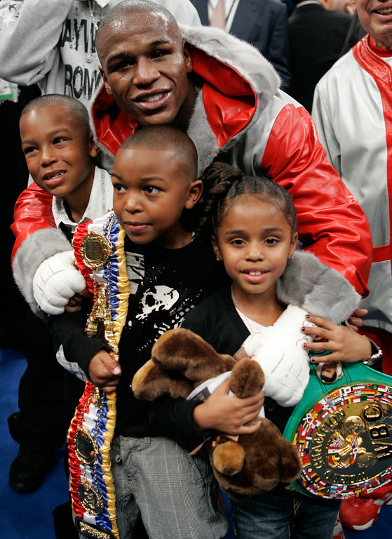 . Floyd Mayweather Jr. poses with his children after knocking out Ricky Hatton, of Great Britain, in the 10th round of their WBC welterweight boxing title fight at the MGM Grand hotel-casino in Las Vegas, Saturday, Dec. 8, 2007. (AP Photo/Jae C. Hong)