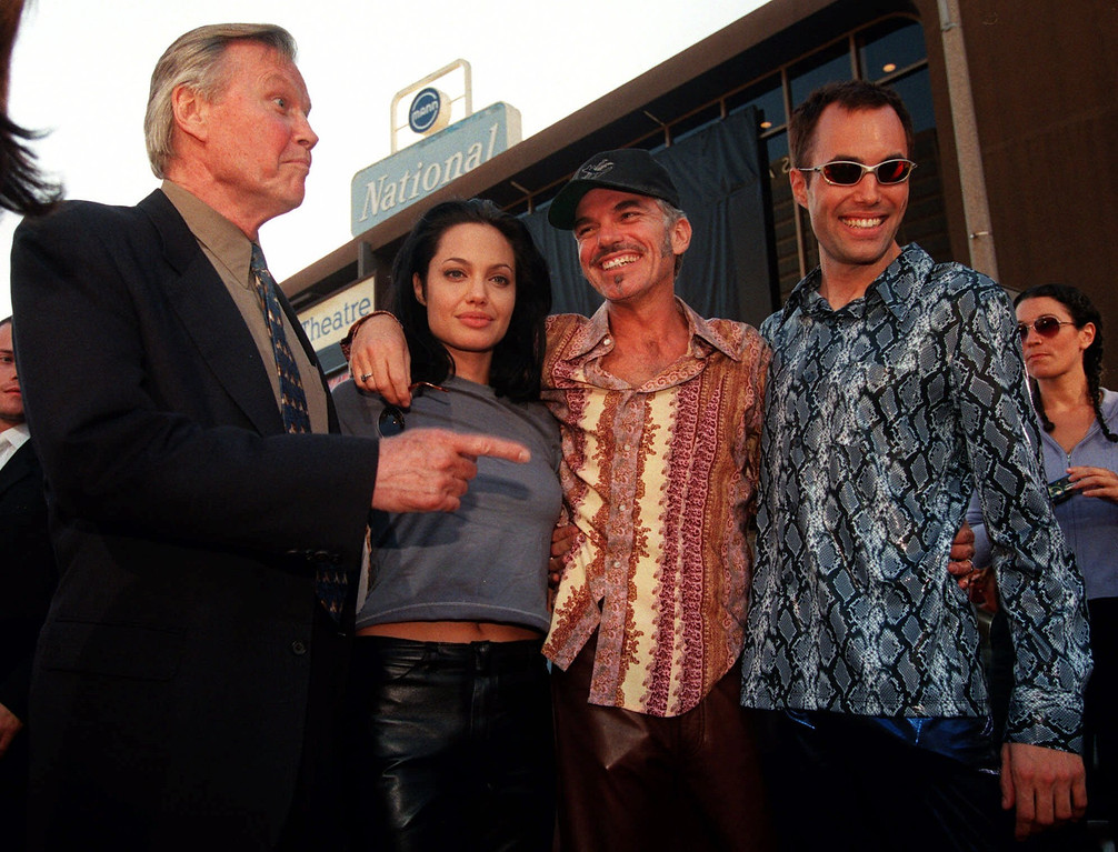 ". Actress Angelina Jolie, second from left, one of the stars of the new action film ""Gone in 60 Seconds,\"" poses with her new husband, actor Billy Bob Thornton, second from right, her father, actor Jon Voight, left, and her brother James Haven Voight at the premiere of the film in Los Angeles, Monday, June 5, 2000. (AP Photo/Chris Pizzello)"