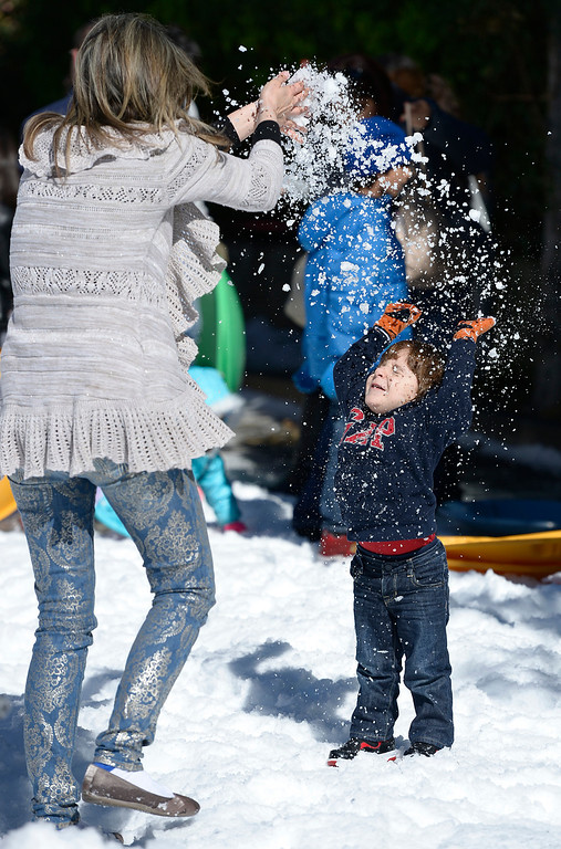 . Angineh Saryan (cq) powders her son David Mirzaian,2, with snow. The Armenian Relief Society is hosting a two-day Winter Wonderland event this weekend, with snow, entertainment, games and amusement rides. Held at the Armenian Apostolic Church in Glendale.  Glendale, CA. February 1, 2014 (Photo by John McCoy / Los Angeles Daily News)