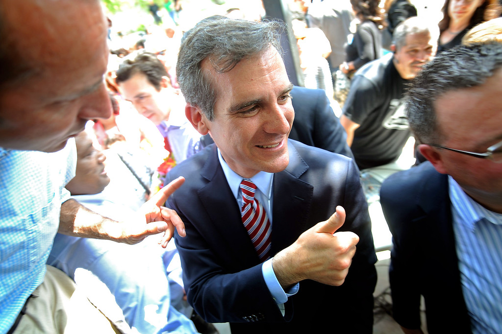. Eric Garcetti heads to his vehicle after holding a press conference at El Centro del Pueblo in Echo Park, CA May 22, 2013.  Eric Garcetti won the mayoral runoff Tuesday in Los Angeles.(Andy Holzman/Staff Photographer)
