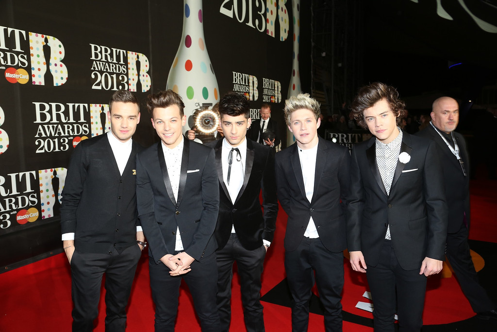. From left, Liam Payne, Louis Tomlinson, Zayn Malik, Niall Horan and Harry Styles of One Direction seen arriving at the BRIT Awards 2013 at the o2 Arena on Wednesday, Feb. 20, 2013, in London. (Photo by John Marshall/Invision/AP)