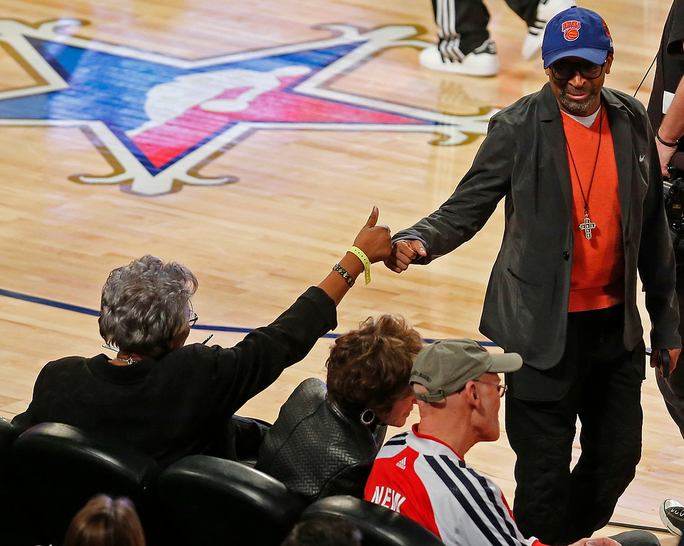 . Vice Chairwoman of the Democratic National Committee Donna Brazile, left fist bumps Director Spike Lee before the skills competition at the NBA All Star basketball game, Saturday, Feb. 15, 2014, in New Orleans. (AP Photo/Bill Haber)