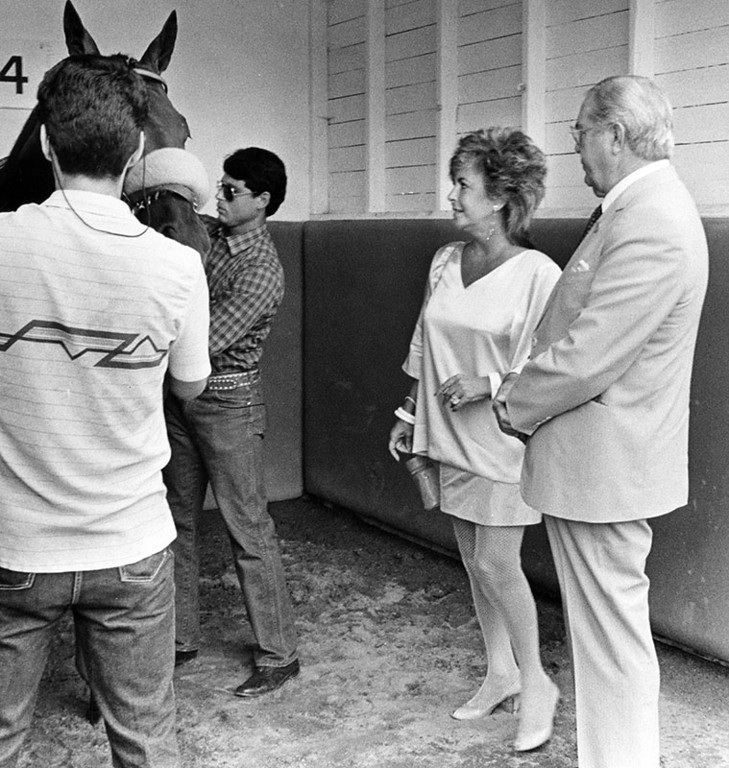. Actress Elizabeth Taylor with her recently purchased horse, Basic Image, at Hollywood Park. Photograph dated July 10, 1985.   (Los Angeles Public Library)