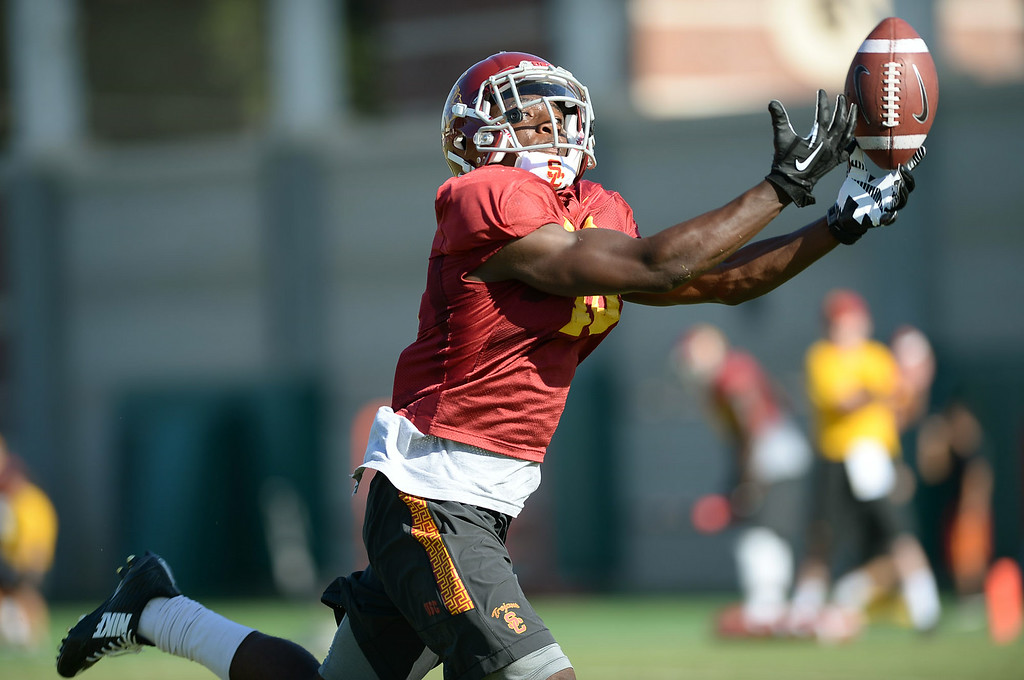 . Ajene Harris tries to catch a pass during practice August 27, 2014 on USC\'s Howard Jones Field.(Andy Holzman/Daily News Staff Photographer)