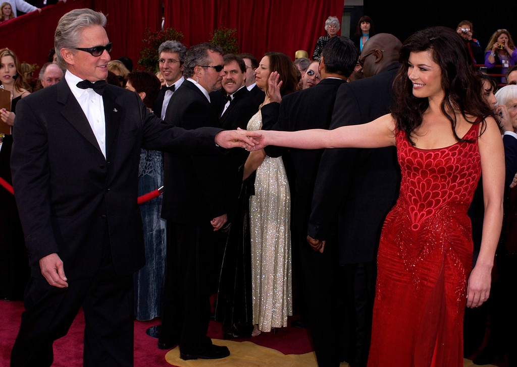 . Welsh actress Catherine Zeta Jones arrives with husband Michael Douglas for the 76th annual Academy Awards Sunday, Feb. 29, 2004, in Los Angeles. Zeta Jones will be a presenter during the telecast.  (AP Photo/Laura Rauch)