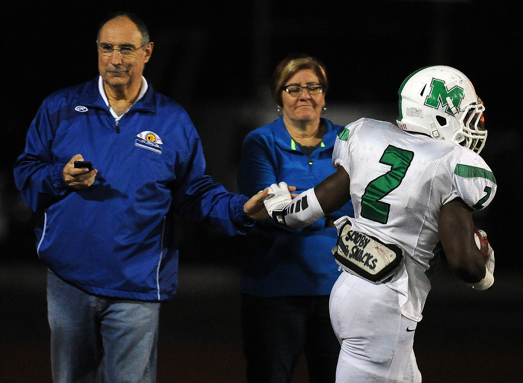 . Monrovia\'s Kurt Scoby (2) high fives a side line fane after catching a pass for a touchdown in the first half of a prep football game against San Marino at Monrovia High School in Monrovia, Calif., on Friday, Nov. 8, 2013.    (Keith Birmingham Pasadena Star-News)