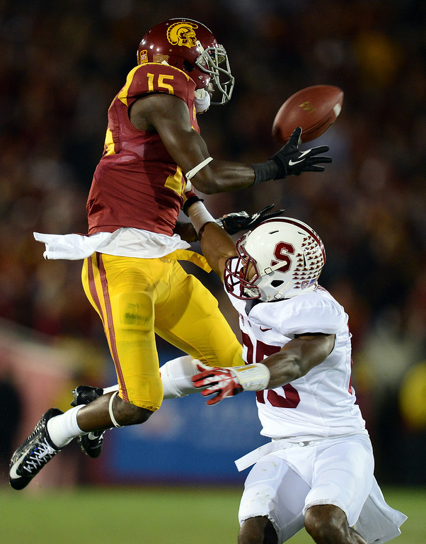 . USC�s Nelson Agholor #15 hauls in a pass as Stanford�s Tyler Gaffney #25 defends during their game at the Los Angeles Memorial Coliseum Saturday, November 16, 2013. (Photos by Hans Gutknecht/Los Angeles Daily News)