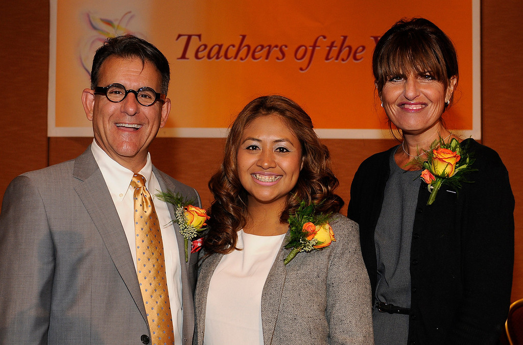 . Michael Hayden from Manhattan Beach USD, Wendy Monroy from Los Angeles UDS and Beth Katz from El Segundo USD. Sixteen teachers from throughout the Los Angeles County were named as Teachers of the Year during a ceremony at the Universal Hilton. Teachers received a cash award from the California Credit Union as well as software and hardware to use in their classrooms from eInstruction. Universal City, CA. 9/27/2013. photo by (John McCoy/Los Angeles Daily News)