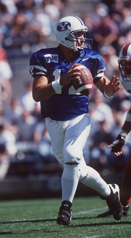 . 28 Sep 1996: Quarterback Steve Sarkisian of the BYU Cougars scans the defense for an open receiver as he rolls out of the pocket during a pass play in the Cougars 31-3 victory over the SMU Mustangs at Cougar Stadium in Provo, Utah.