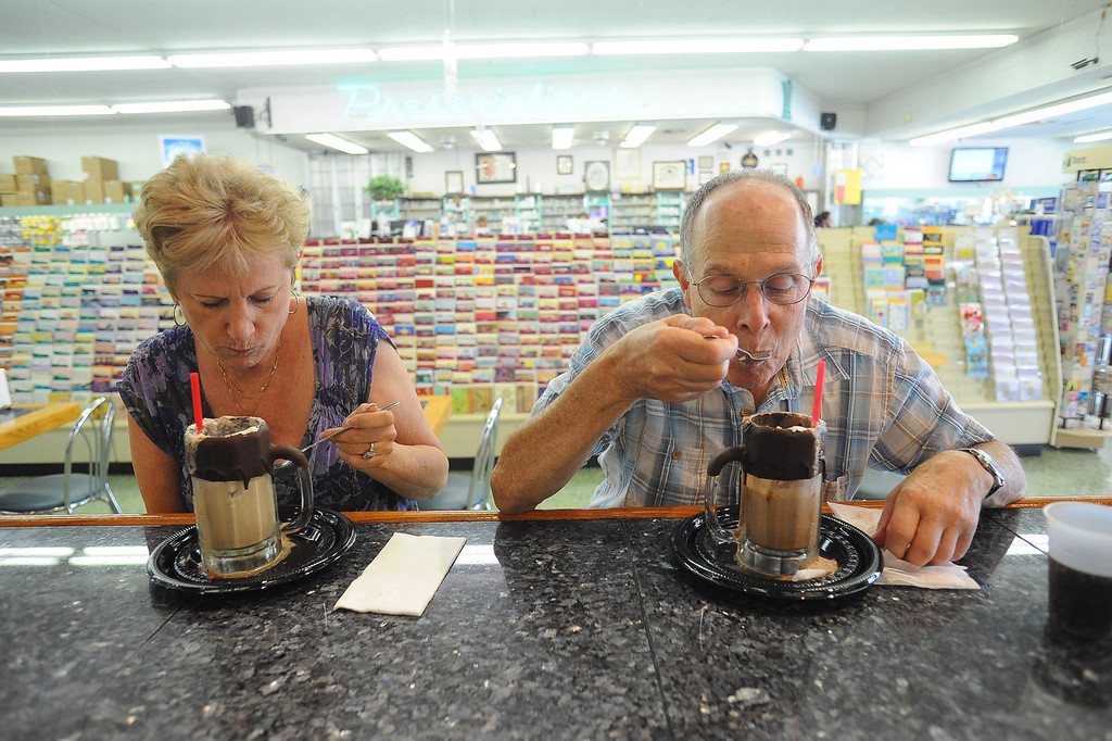 . Marsha Wiedder and Mayer Alson enjoy ice cream soda\'s at Jerry\'s Soda Shoppe in Canoga Park, CA July 3, 2013.  The soda shop is located inside DeSoto Pharmacy and is featured in the  July issue of Food Network Magazine.(Andy Holzman/Los Angeles Daily News)