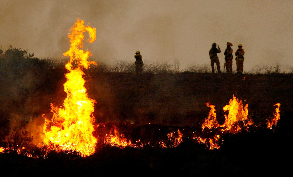 . SAN DIEGO - OCTOBER 27:  Firecrews light a controlled fire in an attempt to counteract the Cedar Fire October 27, 2003 near Lakeside in San Diego, California. The death toll stands at 13, with more than 1,000 homes being reduced to ashes as southern California fires continue to burn. Winds have eased a bit, but 30,000 homes remain threatened by the fires, which have charred more than 400,000 acres, according to officials. Davis, who has activated the National Guard, predicted damages will be in the billions of dollars.  (Photo by Donald Miralle/Getty Images)
