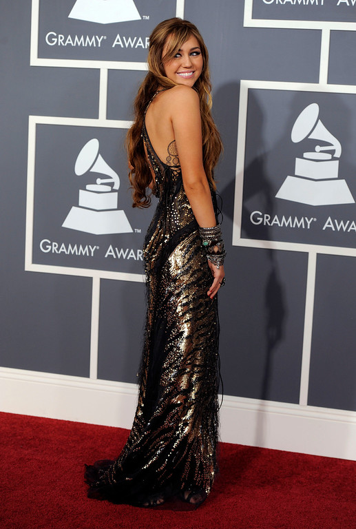 . Miley Cyrus arrives at the 53rd annual Grammy Awards on Sunday, Feb. 13, 2011, in Los Angeles. (AP Photo/Chris Pizzello)