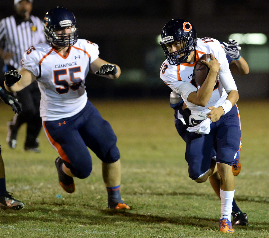 . Chaminade High School quarterback Edward Sias #13 scrambles for a gain during their game against Venice High School at Venice High School in Venice Thursday, August 28, 2014. (Photo by Hans Gutknecht/Los Angeles Daily News)