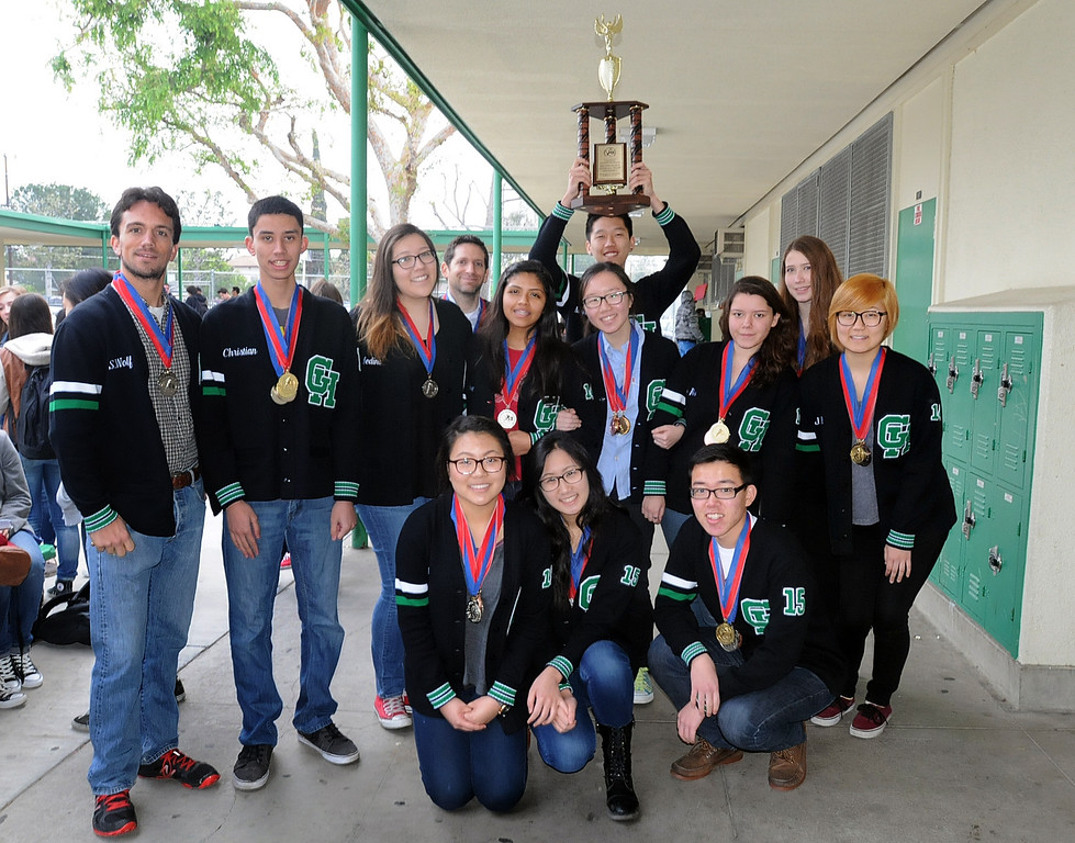 . The Granada Hills Charter High School Academic Decathlon team took second place in the California State Decathlon competition in Sacramento.  El Camino Real Charter High School finished first.  Both teams will travel to Hawaii for the National competition.  The Granada Hills team was greeted with a brief rally and comments from the school\'s Executive Director, Brian Bauer on Monday, March 24, 2014.  The team posses with their trophy before heading back to class.  (Photo by Dean Musgrove/Los Angeles Daily News)