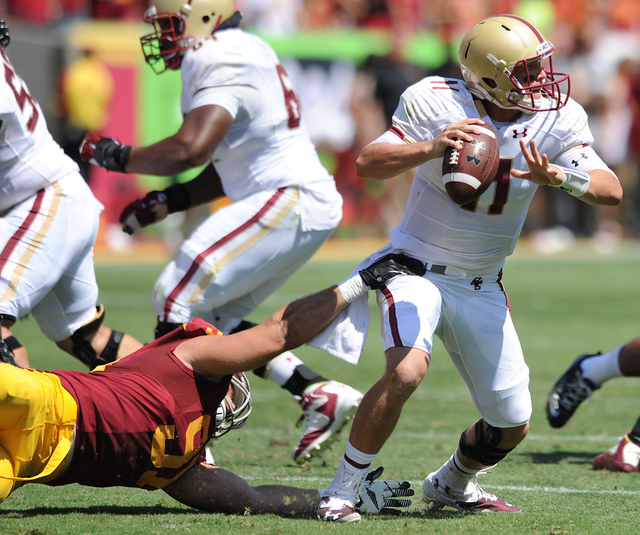 . USC #91 Morgan Breslin gets a hand on Boston QB Chase Rettig in the 2nd quarter. USC was called for roughing the passer after Rettig was hit when he threw the ball out of bounds on the play. USC Plays Boston College at the Coliseum in Los Angeles, CA. 9/14/2013. photo by (John McCoy/Los Angeles Daily News)