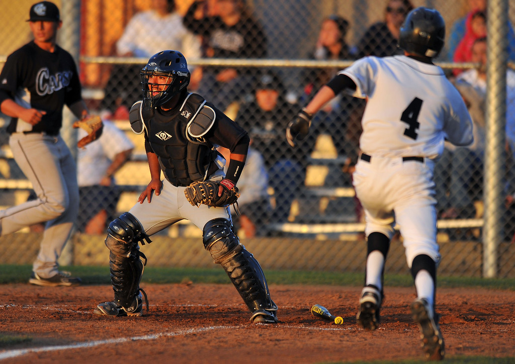 . WILMINGTON - 05/02/2013  (Photo: Scott Varley, Los Angeles Newspaper Group)  Carson vs Banning baseball at Banning High. Banning\'s David Guerrero scores in the 1st as Carson catcher Mark Torressillas awaits the throw.
