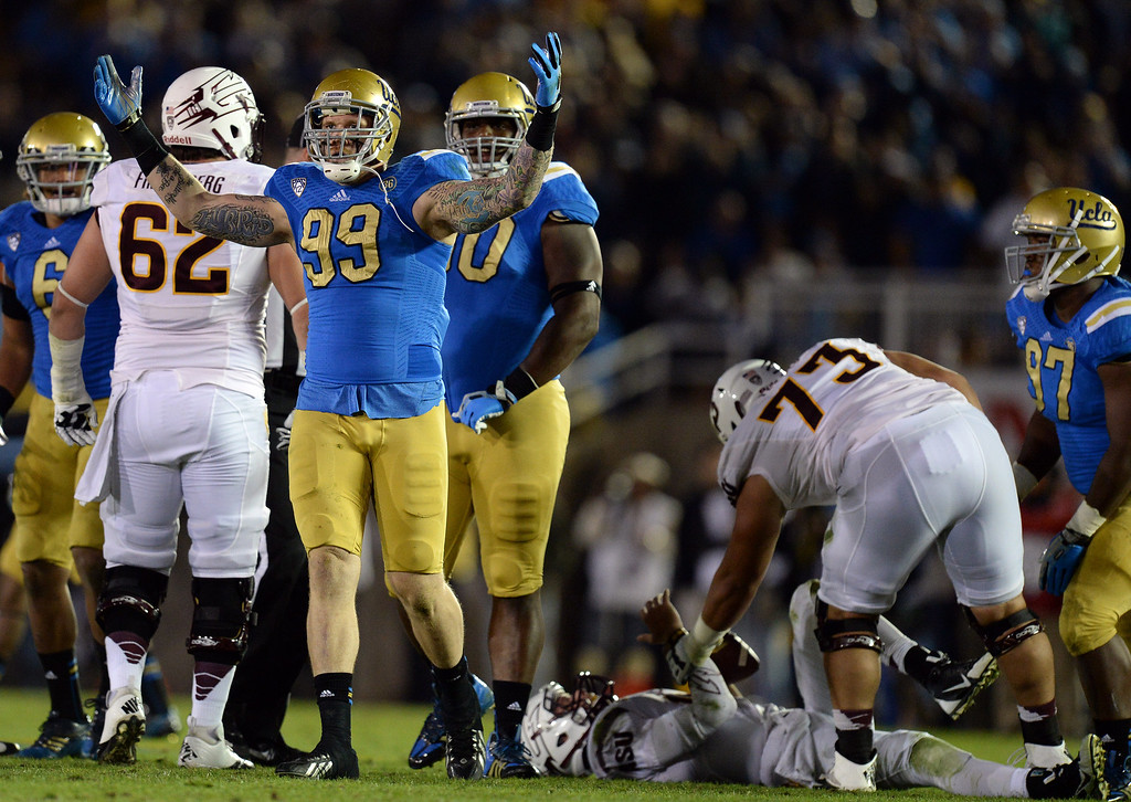 . UCLA�s Cassius Marsh #99 raises his arms after sacking Arizona State quarterback Taylor Kelly #10 during their game at the Rose Bowl Saturday November 23, 2013. (Photos by Hans Gutknecht/Los Angeles Daily News)