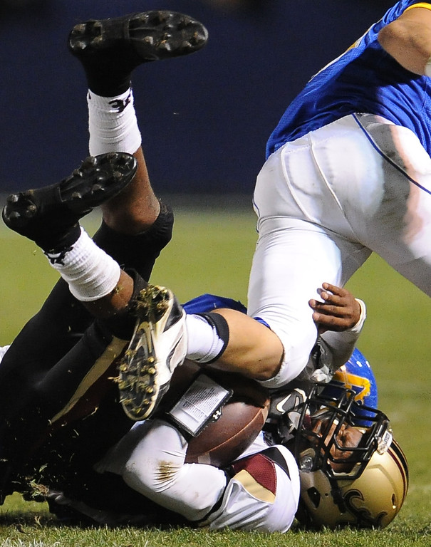 . Bishop Amat\'s Adrian Ortega (19) tackles Alemany quarterback Alif Grayes (2) in the first half of a prep football game at Bishop Amat High School in La Puente, Calif., on Friday, Oct. 25, 2013.    (Keith Birmingham Pasadena Star-News)