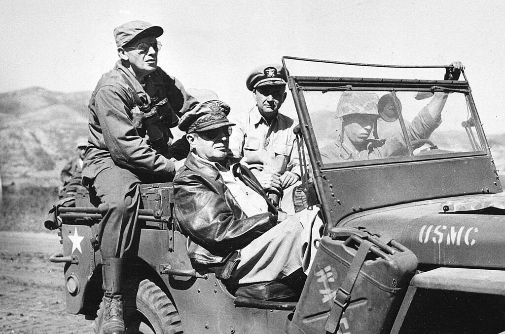 . Gen. Douglas MacArthur, in passenger seat wearing leather jacket, tours the newly opened Inchon Front in Western Korea on Sept. 19, 1950 during the Korean War.  Accompanying him are, Maj. Gen. Edward M. Almond, left, Tenth Corps Commander, and Vice Adm. Arthur D. Struble, Fifth Fleet Commander.  (AP Photo/U.S. Army Signal Corps)HC00408