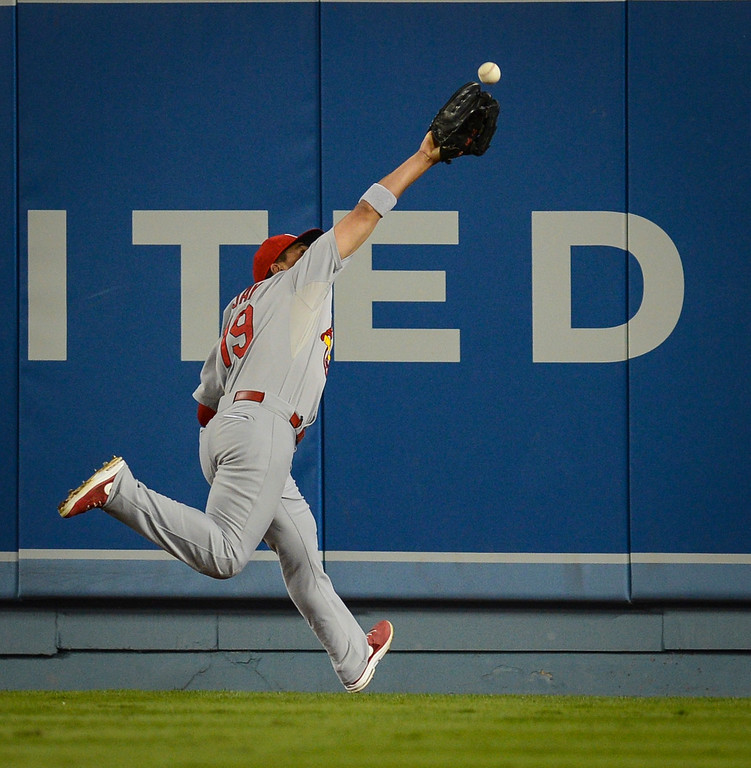 . Cardinals\' Jon Jay can\'t get to this shot by Dodgers\' A.J. Ellis during game action in NLCS game 3 at Dodger stadium Monday, October 14, 2013 ( Photo by Hans Gutknecht/Los Angeles Daily News )