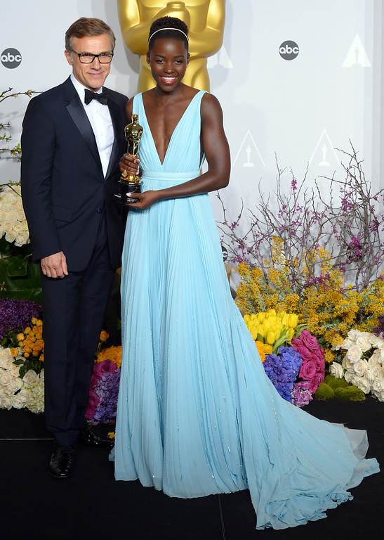 . Christoph Waltz and Lupita Nyong\'o , who won the Oscar for Performance by an Actress in a Supporting Role, backstage at the 86th Academy Awards at the Dolby Theatre in Hollywood, California on Sunday March 2, 2014 (Photo by David Crane / Los Angeles Daily News)