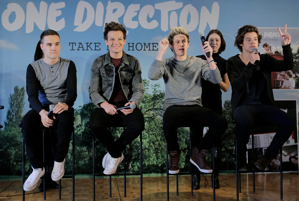 ". British boy band One Direction members, from left, Liam Payne, Louis Tomlinson, Niall Horan and Harry Styles, attend a news conference to promote their second album "" TAKE ME HOME \"" in Tokyo, Friday, Jan. 18, 2013.(AP Photo/Itsuo Inouye)"