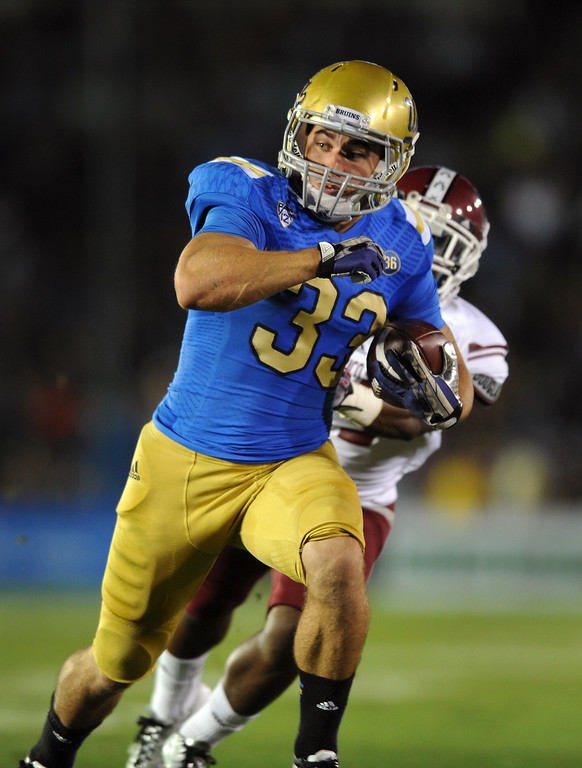 . UCLA RB Steven Manfro breaks a long run against New Mexico State in the first quarter, Saturday, September 21, 2013, at the Rose Bowl. (Photo by Michael Owen Baker/L.A. Daily News)