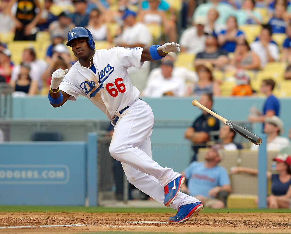 . Los Angeles Dodgers\' Yasiel Puig hits a triple against the Philadelphia Phillies during the fifth inning of a baseball game in Los Angeles on June 30, 2013.  Dodgers won 6-1.    (AP Photo/Mark J. Terrill, File)