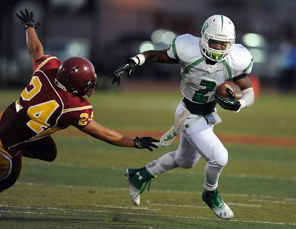 . Monrovia\'s Kurt Scoby (2) runs for a touchdown against Arcadia in the first half of a prep football game at Arcadia High School in Arcadia, Calif. on Friday, Sept. 13, 2013.   (Photo by Keith Birmingham/Pasadena Star-News)