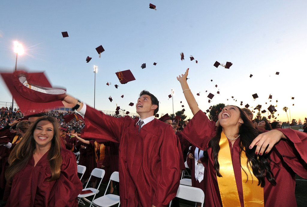 . Isaac Vermilye, center, tosses his cap with classmates during La Serna High School\'s 51st Annual Commencement at La Mirada High School stadium in La Mirada on Thursday June 13, 2013. La Serna marked the commencement of 635 graduates and marking Principal Ann Fitzgerald\'s first graduation as principal. (SGVN/Staff Photo by Keith Durflinger)