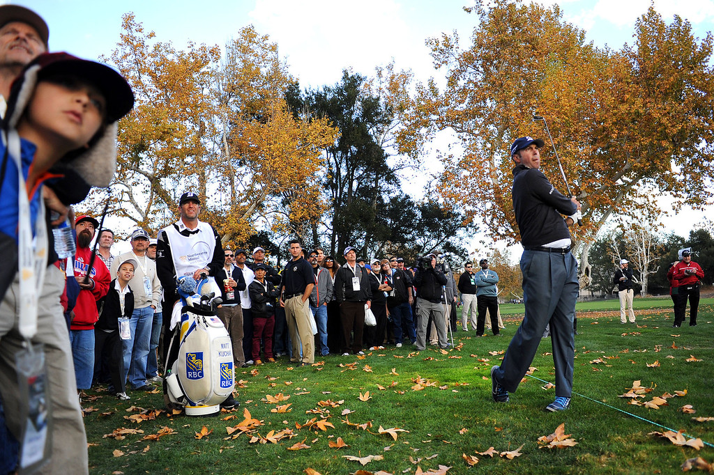 . Matt Kuchar hits a shot from the rough during the first-round of Tiger Woods\' Northwestern Mutual World Challenge at Sherwood Country Club in Thousand Oaks, CA Thursday December 5, 2013.(Andy Holzman/Los Angeles Daily News)