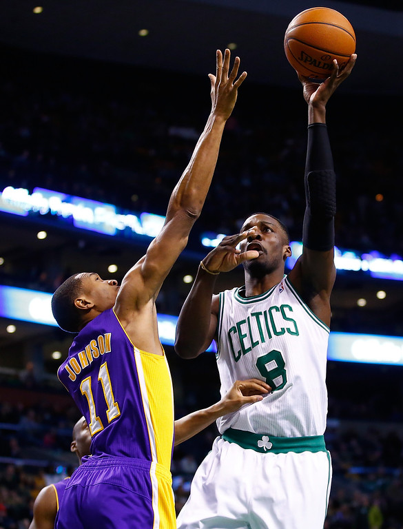 . BOSTON, MA - JANUARY 17: Jeff Green #8 of the Boston Celtics takes a shot over Wesley Johnson #11 of the Los Angeles Lakers in the first quarter during the game at TD Garden on January 17, 2014 in Boston, Massachusetts.   (Photo by Jared Wickerham/Getty Images)