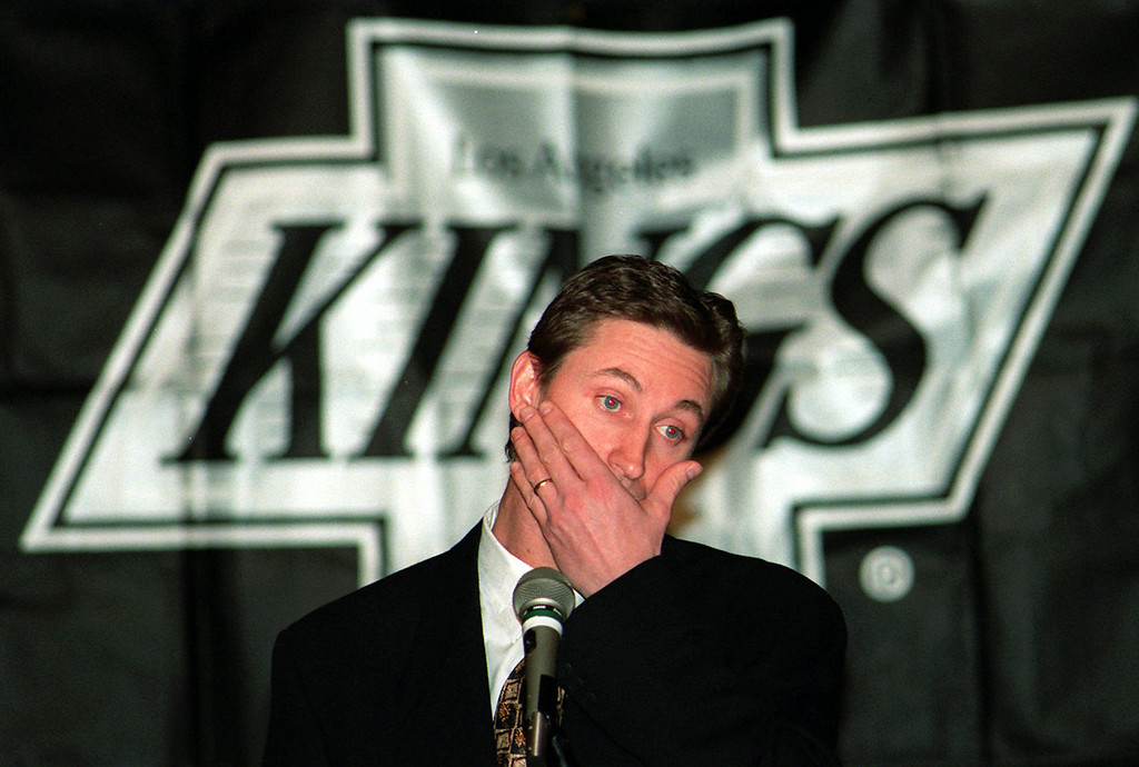 """. Wayne Gretzky reacts during a news conference in Los Angeles, Tuesday, Feb. 27, 1996, where he announced that he has been traded to the St. Louis Blues. Gretzky said, \""""I am emotionally drained.\"""" Gretzky, the hockey great who failed to win a Stanley Cup in Los Angeles, was traded to the St. Louis Blues on Tuesday Feb. 27, ending weeks of rumors and speculation about his future.  (AP Photo/Kevork Djansezian)"""