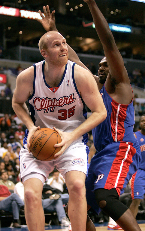 . Los Angeles Clippers center Chris Kaman (35) looks to score defended by Detroit Pistons forward Jason Maxiell in the 2nd half of their NBA basketball game in Los Angeles, Wednesday, Feb. 24, 2010. The Clippers won 97-91. (AP Photo/Jason Redmond)