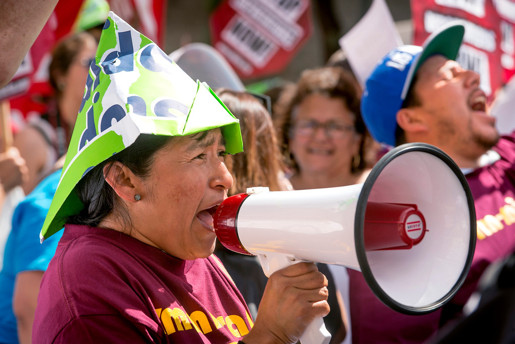 . CHIRLA member Gillberta Gonzalez chants with the help of a megaphone during speeches before the march.  The Coalition for Humane Immigrant Rights of Los Angeles (CHIRLA) joined area organizations and coalitions to march in honor of worker contributions and denounce deportations of undocumented immigrants living in the United States May 1, 2014.   (Staff photo by Leo Jarzomb/San Gabriel Valley Tribune)