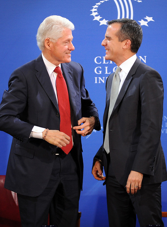 . President Bill Clinton and Los Angeles Mayor Eric Garcetti share the stage during the Clinton Global Initiative infrastructure meeting at LA City Hall Thursday, April 3, 2014.  The meeting was the fifth convened by President Clinton with mayors to discuss infrastructure in their cities.(Andy Holzman/Los Angeles Daily News)