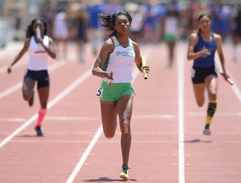 . Long Beach Poly\'s Arianna Washington anchors to a win in the 4x100 meter Division 1 relay race of the CIF Southern Section Track and Field Championships Saturday at Mt. SAC. 20130518 Photo by Steve McCrank / Staff Photographer
