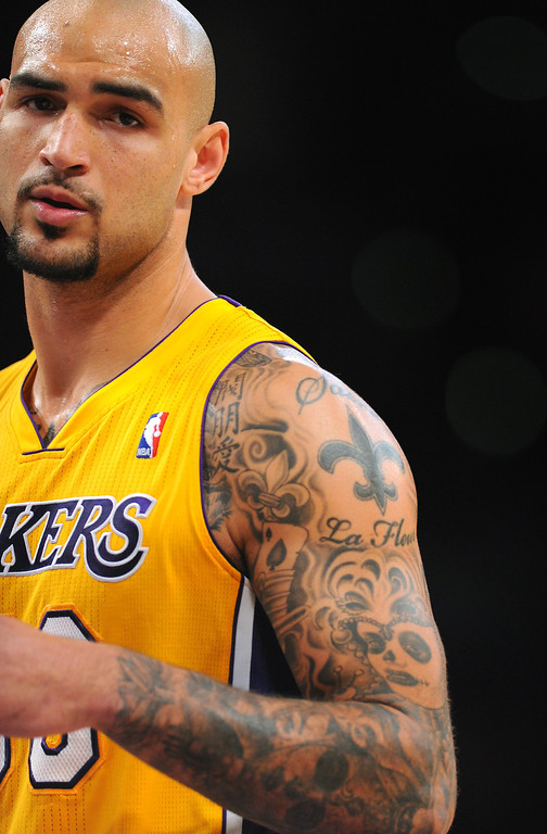 . Laker center Robert Sacre and his tattoos, Friday, December 20, 2013, at Staples Center. (Photo by Michael Owen Baker/L.A. Daily News)