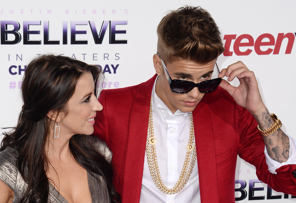 ". Singer Justin Bieber (R) and mother Pattie Mallette attend the world premiere of ""Justin Bieber\'s BELIEVE,\"" December 18, 2013 at the Regal Cinemas at LA Live in Los Angeles, California.  The film opens nationwide on Christmas Day.         (ROBYN BECK/AFP/Getty Images)"
