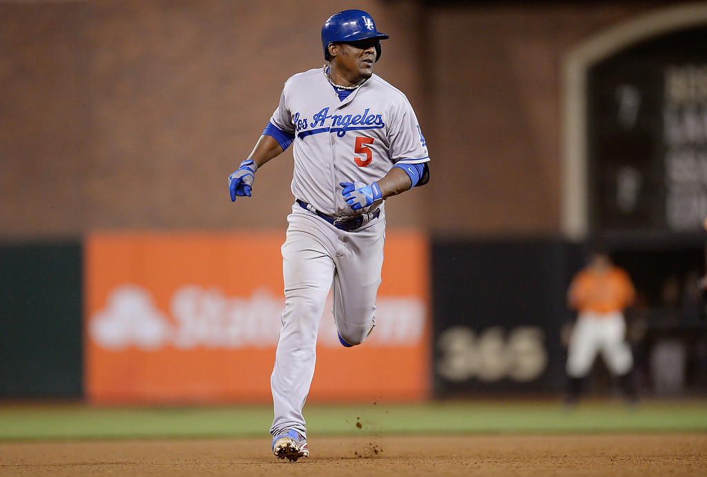 . Juan Uribe #5 of the Los Angeles Dodgers trots around the bases after hitting a two-run homer in the seventh inning against the San Francisco Giants at AT&T Park on July 5, 2013 in San Francisco, California.  Dodgers won 10-2.   (Photo by Thearon W. Henderson/Getty Images)