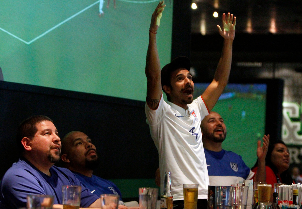 . From left Chris Lopez, of Colton, Chris Cruz, of Riverside, Antonio Chavez, of Corona, and Carols Sandoval, of Eastvale, watch the USA vs Ghana World Cup soccer match on Monday, June 16, 2014 at Dave and Busters in Ontario, Ca. (Micah Escamilla/Inland Valley Daily Bulletin)
